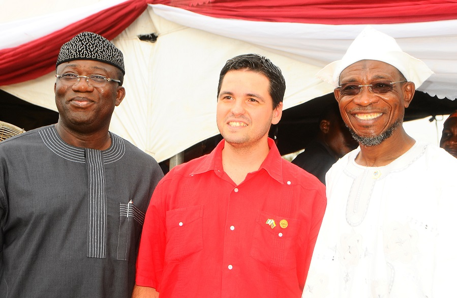 From right, Governor State of Osun, Ogbeni Rauf Aregbesola; Minister Counselor, Embassy of the Bolivarian Republic of Venezuela, Miguelangel Vecchia and Ekiti State Governor, Dr Kayode Fayemi, at the Distribution of free Education Materials by the Venezuelan Ambassador in the Country  to Students in Public Schools, commemorating 3rd years Aniversary of Aregbesola's Administration,  at Anthony Udofia Elementary School, Osogbo, State of Osun on Wednesday 27-11-2013
