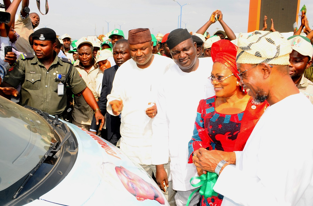 From right, Governor State of Osun, Ogbeni Rauf Aregbesola; his Deputy, Mrs Titi Laoye-Tomori; Chairman, All Progressive Congress (APC) Osun chapter, Elder Adelowo Adebiyi; Secretary Osun APC, Prince Gboyega Famodun and others, during the Presentation of Support vehicles and Endorsement of Governor Aregbesola for Second term running by the Councillorship Forum 332 at Freedom Park, Osogbo the State of Osun, on Tuesday 05-11-2013