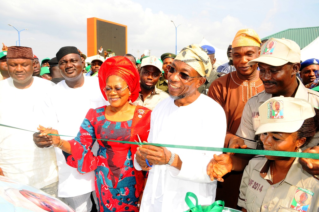 Governor State of Osun, Ogbeni Rauf Aregbesola (4th left); his Deputy, Mrs Titi Laoye-Tomori (3rd left); Secretary to the State Government of Osun, Alhaji Moshood Adeoti (2nd right); Chairman, All Progressive Congress (APC) Osun chapter, Elder Adelowo Adebiyi (2nd left); Secretary Osun APC, Prince Gboyega Famodun (left); State Chairman, Councillorship Forum, Mr Yinka Olayiwola (right) and others, during the Presentation of Support vehicles and Endorsement of Governor Aregbesola for Second term running by the Councillorship Forum 332 at Freedom Park, Osogbo the State of Osun, on Tuesday 05-11-2013