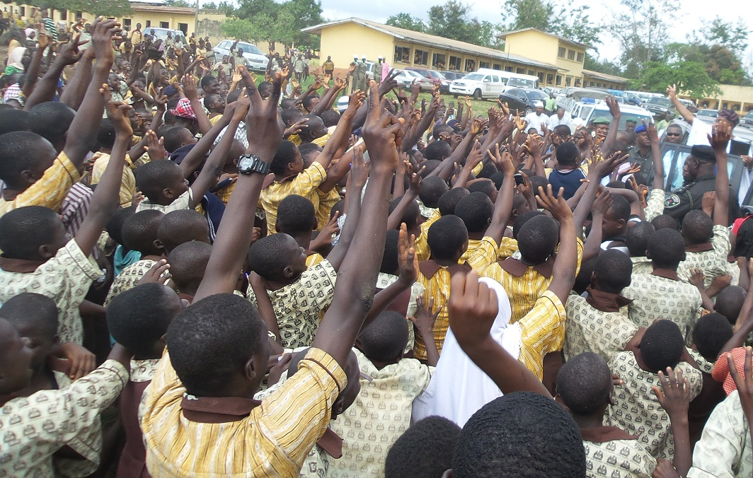 Governor, State of Osun, Ogbeni Rauf Aregbesola (right), acknowledging cheers from Students of Seventh Day Adventist Grammar School, Ede, on his arrival at a public assessment on his administration, at the School premises in Ede on Thursday 31-10-2013