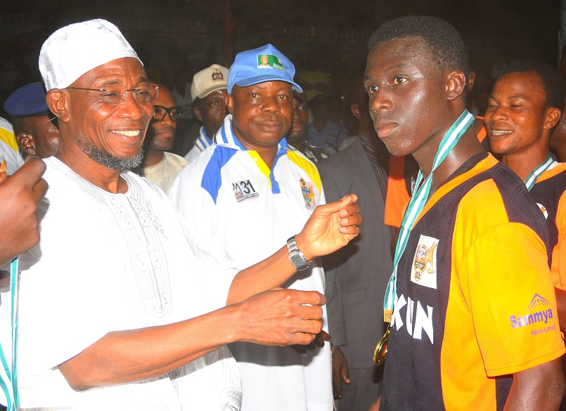 From left, Governor State of Osun, Ogbeni Rauf Aregbesola; Special Adviser to the Governor on Youth, Sports and Special needs, Comrade Biyi Odunlade; Member Obokun Local Government team, Adewumi Moses and others, after winning the State of Osun Under-17 Governor's Cup, at technical college, Osogbo the State of Osun