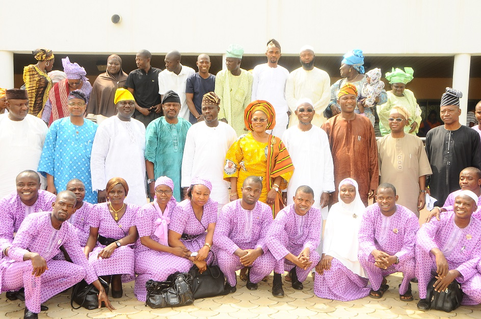 Governor State of Osun, Ogbeni Rauf Aregbesola (4th right); his Deputy, Mrs Titi Laoye-Tomori [7th left]; Commissioner for Agriculture, Prince Wale Adedoyin (4th left) and other State Executive members, during a reception for the first batch of 40th Youths of the State of Osun after their Agricultural Training in Saxony Anhalt, Germany. With them are their parents at back row, at Government House Osogbo on Tuesday 03/12/2013.