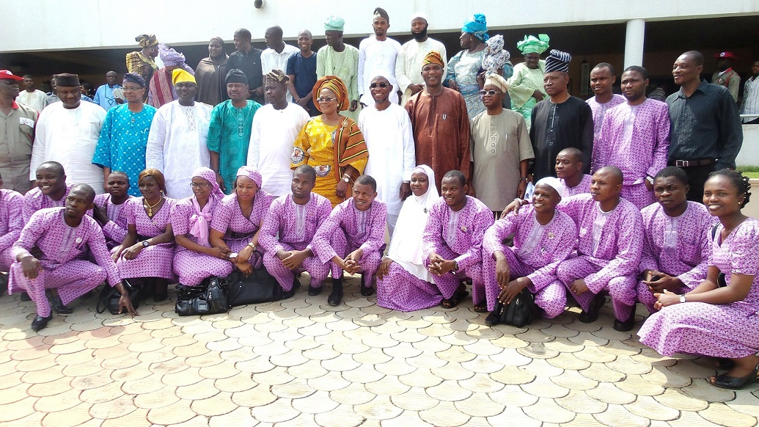 Governor State of Osun, Ogbeni Rauf Aregbesola (middle); his Deputy, Mrs Titi Laoye-Tomori ; Commissioner for Agriculture, Prince Wale Adedoyin (5th left); SSG, Alhaji Moshood Adeoti (6th right) and other State Executive members, during a reception for the first batch of Youths of the State of Osun after their Agricultural Training in Saxony Anhalt, Germany. With them are their parents at back row, at Government House Osogbo on Tuesday 03/12/2013