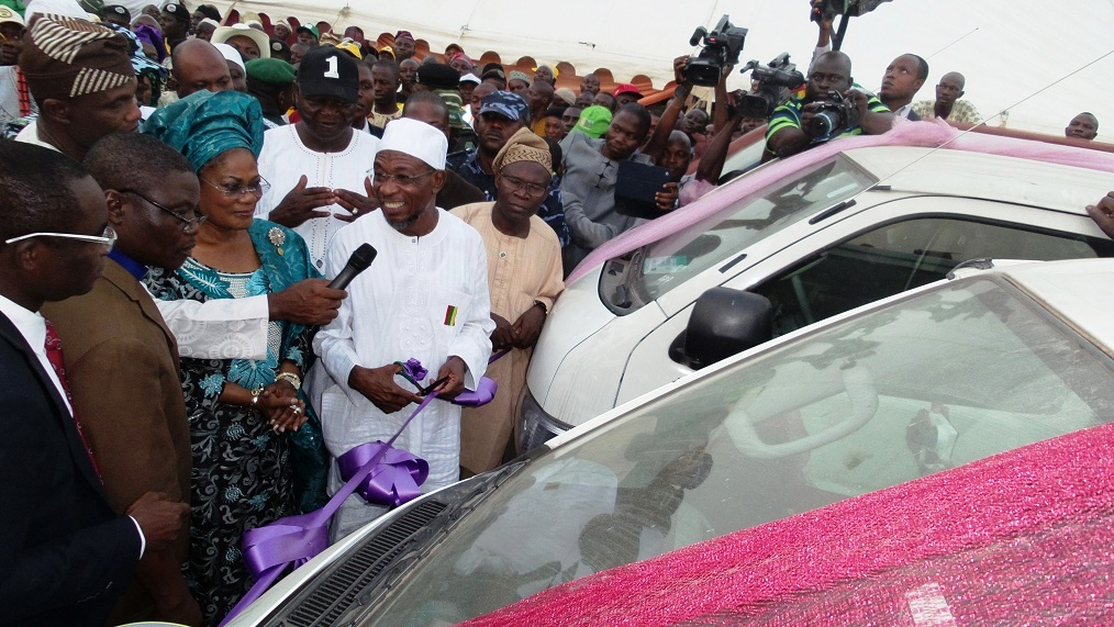 From left, Sterling Bank Regional Business Director (South West), Mr.Ayo Adebayo; Chairman, Christian Association of Nigeria (CAN), State of Osun, Reverend  Elijah Ogundiya; State of Osun Deputy Governor, Mrs Titi Laoye-Tomori; Governor Rauf Aregbesola; Commissioner for Commerce, Cooperative and Empowerment, Hon. Ismaila Jayeoba Alagbada  and others, during the Commissioning and Distribution of  70 Vehicles (18 sitter Toyota Commuter Bus) to members of the National Union of Road Transport Workers (NURTW) by the State Government, at the Governor's office, Abere, Osogbo, State of Osun on Monday 23-12-2013