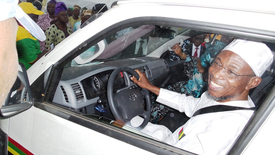 Governor State of Osun, Ogbeni Rauf Aregbesola, test driving a vehicle, during the Commissioning and Distribution of 70 Vehicles (18 sitter Toyota Commuter Bus) to members of the National Union of Road Transport Workers (NURTW) by the State Government, at the Governor's office, Abere, Osogbo, State of Osun on Monday 23-12-2013
