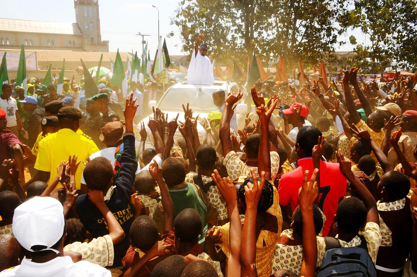 "Governor State of Osun, Ogbeni Rauf Aregbesola acknowledging cheers from  Ijesha people while rejoicing with prayer of supports for his Second Term in office  immediately after the 6th edition of an interactive programme tagged, ""Gban-gba Dekun"" in Ijesha South Federal Constituency consisting of Ilesa West, Ilesa East, Atakumosa East and Atakumosa West Local Governments at Ilesa High School, Ilesa, State of Osun last week"
