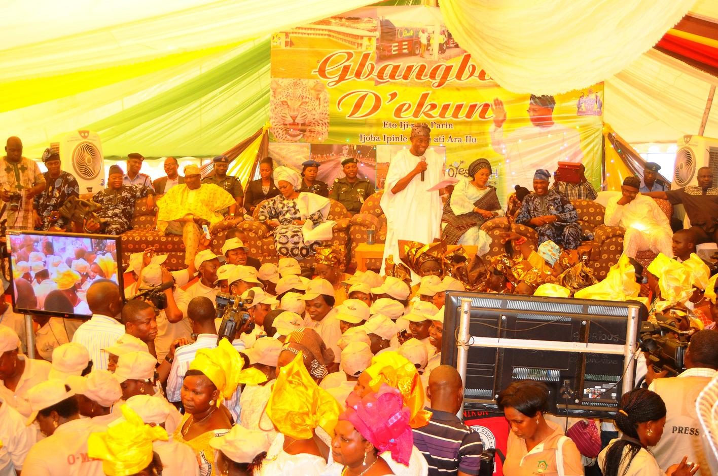 "Governor State of Osun, Ogbeni Rauf Aregbesola (standing) addressing the people of Ijeshaland after their word of support for his Second Term in office,  during the 6th edition of an interactive programme tagged, ""Gban-gba Dekun"" in Ijesha South Federal Constituency consisting of Ilesa West, Ilesa East, Atakumosa East and Atakumosa West Local Governments at Ilesa High School, Ilesa, State of Osun last week"