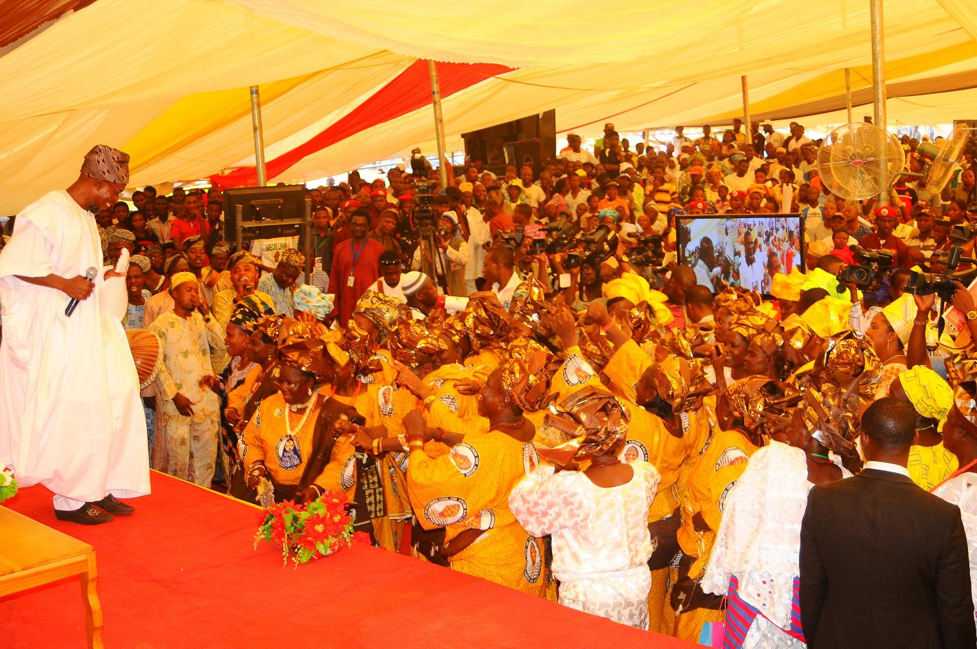 "Governor State of Osun, Ogbeni Rauf Aregbesola (left) dancing with the State  market women and People of Ijeshaland after their word of support for his Second Term in office, during the 6th edition of an interactive programme tagged, ""Gban-gba Dekun"" in Ijesha South Federal Constituency consisting of Ilesa West, Ilesa East, Atakumosa East and Atakumosa West Local Governments at Ilesa High School, Ilesa, State of Osun last week"
