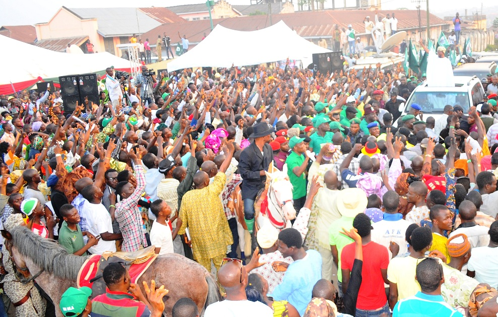 Governor State of Osun, Ogbeni Rauf Aregbesola acknowledging cheers from supporters, at the 2013 Iwude-Ijesha Festival in Ilesa, State of Osun on Saturday 28-12-2013