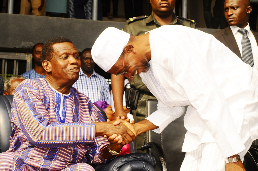 General Overseer, Redeemed Christian Church of God (RCCG), Pastor Enoch Adeboye (left) and Governor State of Osun, Ogbeni Rauf Aregbesola (right), at the Special End of the Year Prayer tagged: 'Lets' go a Fishing in Federal Polytechnic Ede Sport Complex, Ede, the State of Osun on Tuesday 24-12-2013