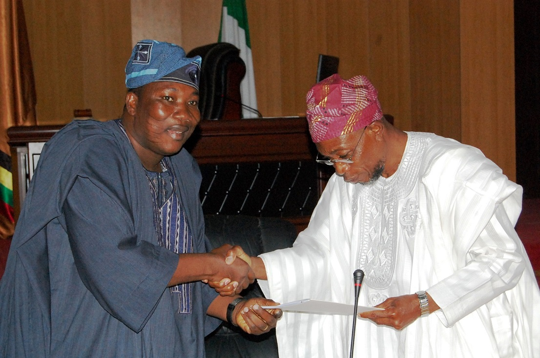 Governor State of Osun, Ogbeni Rauf Aregbesola (right) presenting the Executive Bill on creation of additional 27 Local Governments to the Speaker, State House of Assembly of Osun, Honourable Najeem Salam (left) at the Hallowed Chamber of the House, Osogbo, State of Osun on Monday 16-12-2013