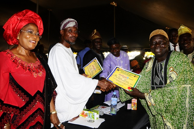 Governor State of Osun, Ogbeni Rauf Aregbesola, presenting certificate of Award as Best Farmer of the Year to Alhaji Sule Taiwo. With the is Deputy Governor, Mrs Titi Laoye-Tomori and others, during 2013 Osun Farmers Festival, organised by the Ministry of Agriculture and Food Security in conjunction with all Farmers Association in the State, held at the Government Technical College, Osogbo, State of Osun