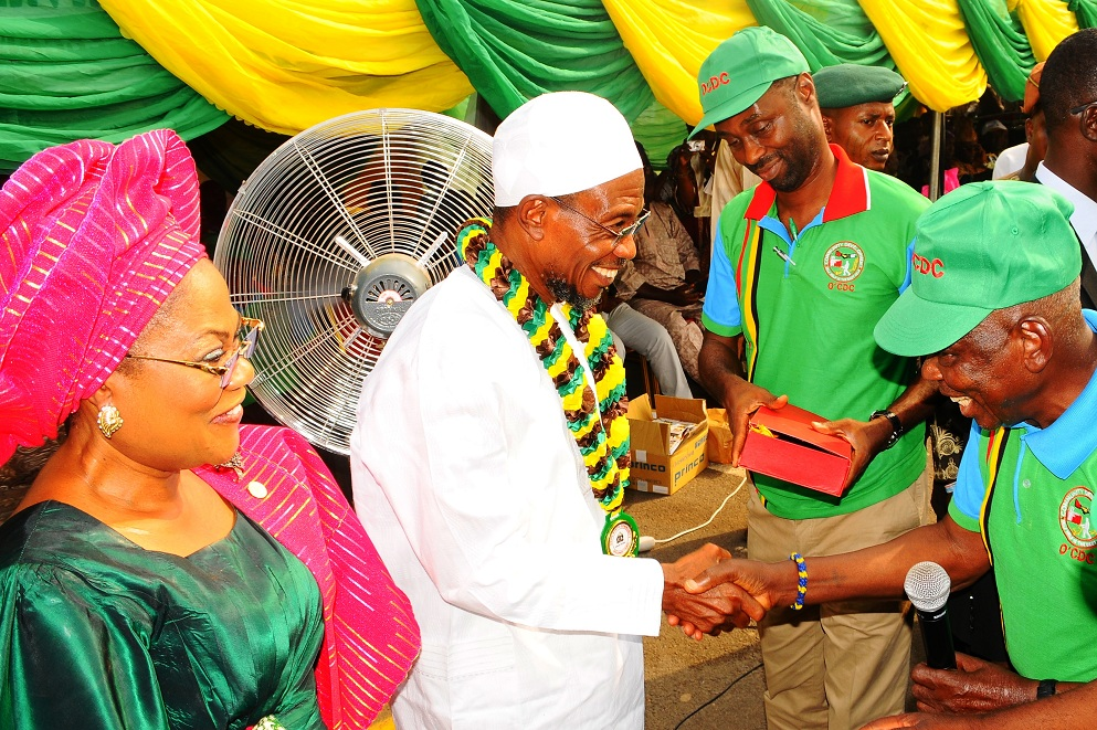 Governor State of Osun, Ogbeni Rauf Aregbesola (middle); his Deputy, Mrs Titi Laoye-Tomori (left);  Special Adviser to the Governor on Rural Development and Community Affairs, Mr Kunle Ige (behind) and Chairman, Community Development Council, Chief Michael Okediya (right), during the Governor's Investiture as Grand Patron of the Council and Support for his second term in office, at Nelson Mandela Freedom Park, Osogbo, State of Osun on Tuesday 07-01-2014