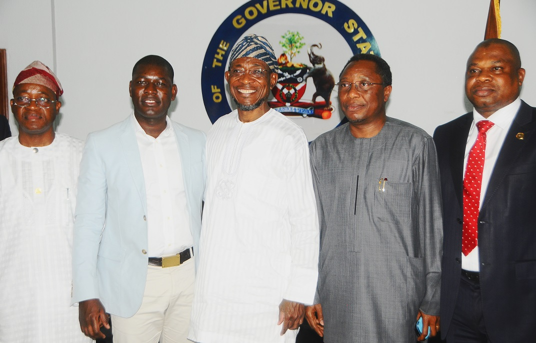 Governor, State of Osun, Ogbeni Rauf Aregbesola in hand shake with the Chairman of RLG Communication, Mr. Roland Agambire, Director ICT State of Osun, Mr. Adebambo Bashorun (2 right) and Prince Adefioye Ade (2nd Left), during a visit to the Governor at Government House Osogbo, State of Osun, at the weekend