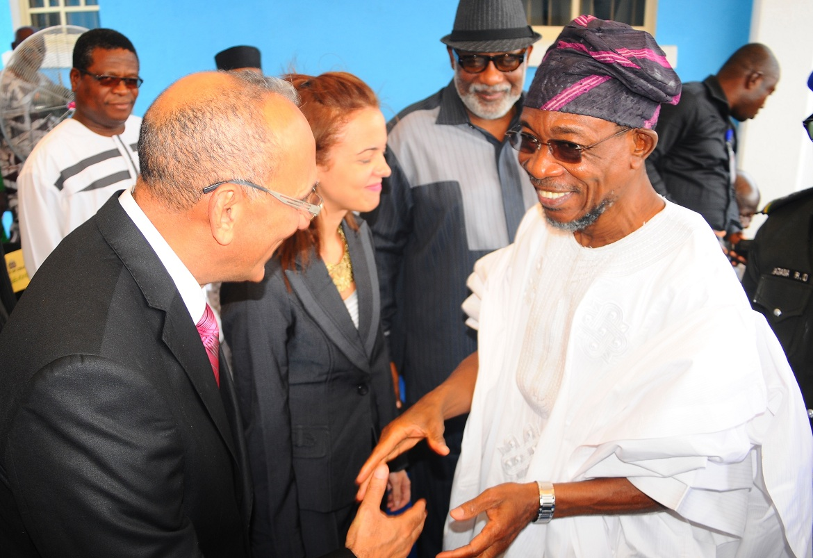 Governor State of Osun,  Ogbeni Rauf Aregbesola, exchanging pleasantries with Dominican Partners RLG, Mr Javier Dotel (left); Stephaine Dotel (2nd left); APC Chieftain, Ondo State, Mr Rotimi Akeredolu (2nd right) and a Veteran Journalist, Mr  Segun Babatope (left), at the commissioning of RLG/Adulawo Technology City, in Ilesa, State of Osun, on Thursday 30-01-2014
