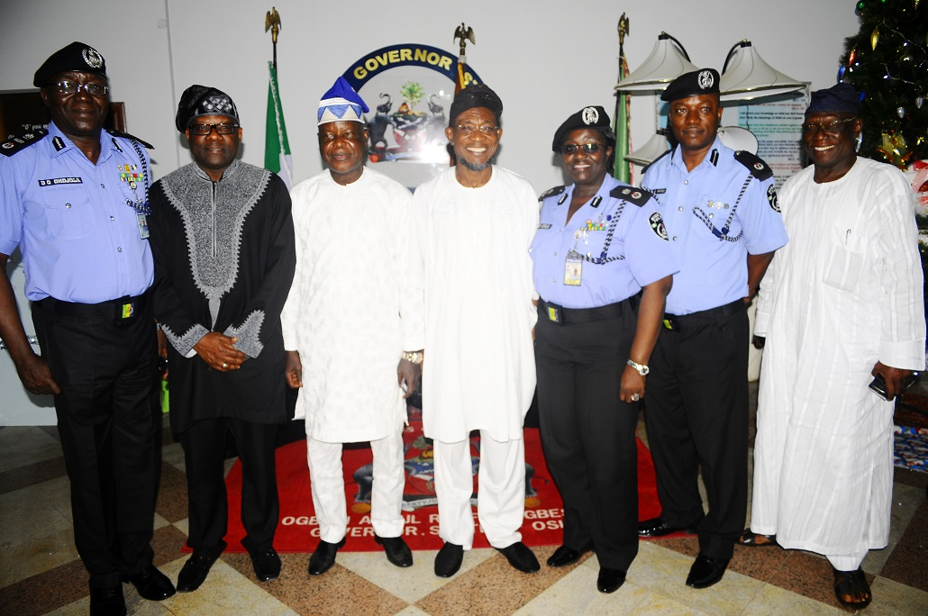 Governor State of Osun, Ogbeni Rauf Aregbesola (centre); Chairman, Police Service Commission, Sir Mike Okiro (3rd left); Assistant Inspector General of Police, Zone 11, David Omojola (left); Commissioner of Police, Osun Command, Mrs Dorothy Gimba (3rd right); Dr Sylvester Odije (2nd left) and others, during a Courtesy visit to the governor in Government House, Osogbo, State of Osun on Friday 27-12-2013