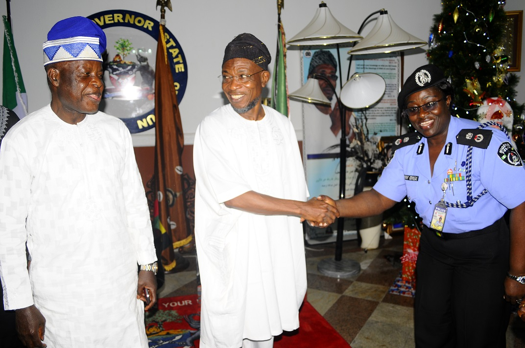 Governor State of Osun, Ogbeni Rauf Aregbesola (middle); Chairman, Police Service Commission, Sir Mike Okiro (left) and Commissioner of Police, Osun Command, Mrs Dorothy Gimba (right), during a Courtesy visit to the governor in Government House, Osogbo, State of Osun on Friday 27-12-2013