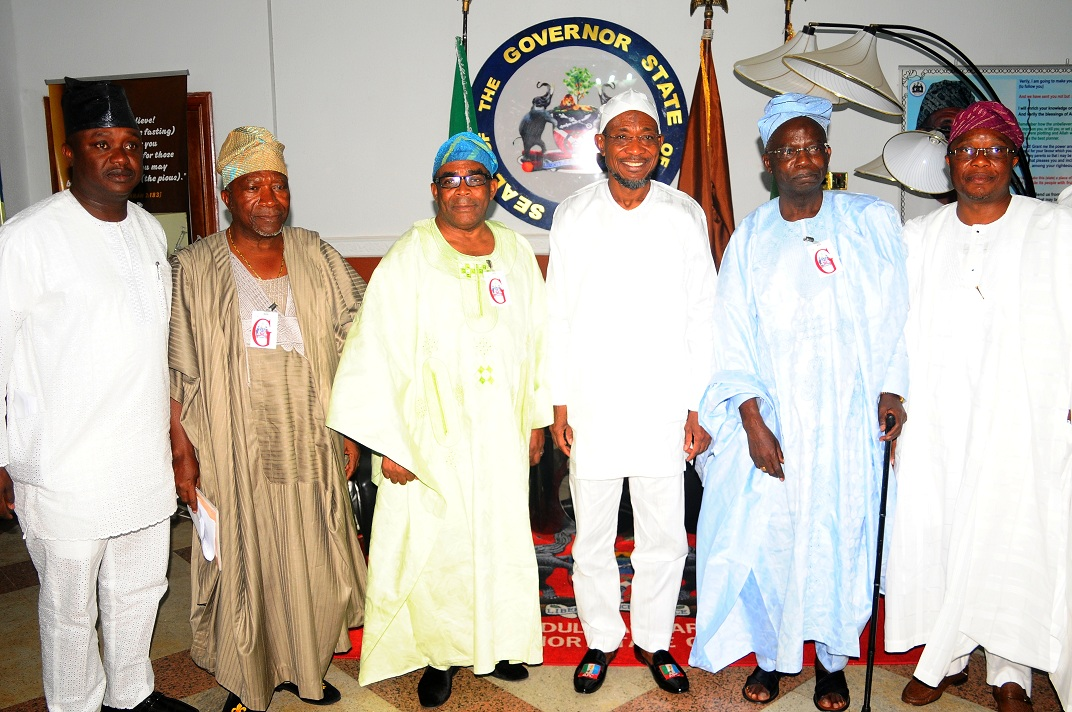 Governor State of Osun, Ogbeni Rauf Aregbesola (3rd right); Aare of Ife, Aare Muyiwa Omisade (2nd left); Chairman, Osun State University Governing Board, Professor Gabriel Olawoyin (2nd right); Member National Assembly - Osun East Senatorial District, Senator Babajide Omoworare (left); Obasewa of Ife, Chief John Odeyemi (3rd left);  and Prince of Ife, Ade Adefioye (right), during the Dignitaries from Ile-Ife's solidarity  Visit to Mr Governor in Osogbo, State of Osun on Tuesday 07-01-2014