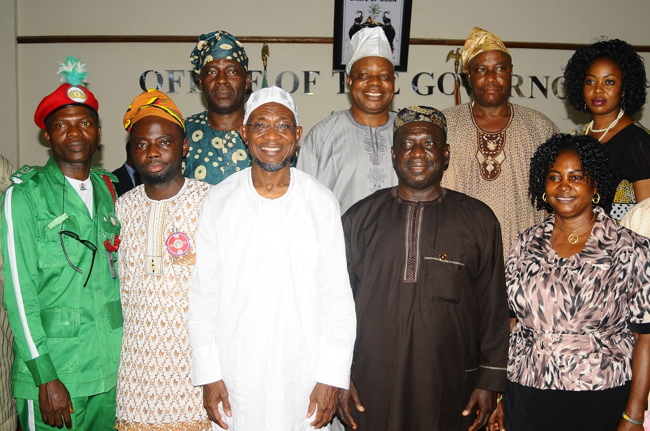 Governor State of Osun, Ogbeni Rauf Aregbesola (3rd left); State Director, National Orientation Agency (NOA), Mr Remi Omowon (2nd right); Deputy Director of the Agency, Mrs Yomi Olasinde (right); Commissioner for Local Government and Chieftaincy Affairs, Barrister Kolapo Alimi (2nd left); Commandant, Community Support Brigade (CSB), Mr Sunday Kayode (left) and others, during the New State Director of the Agency's Courtesy Visit and Investiture of the Governor as Patron of Community Support Brigade (CSB) at the Governor's office, Osogbo, State of Osun