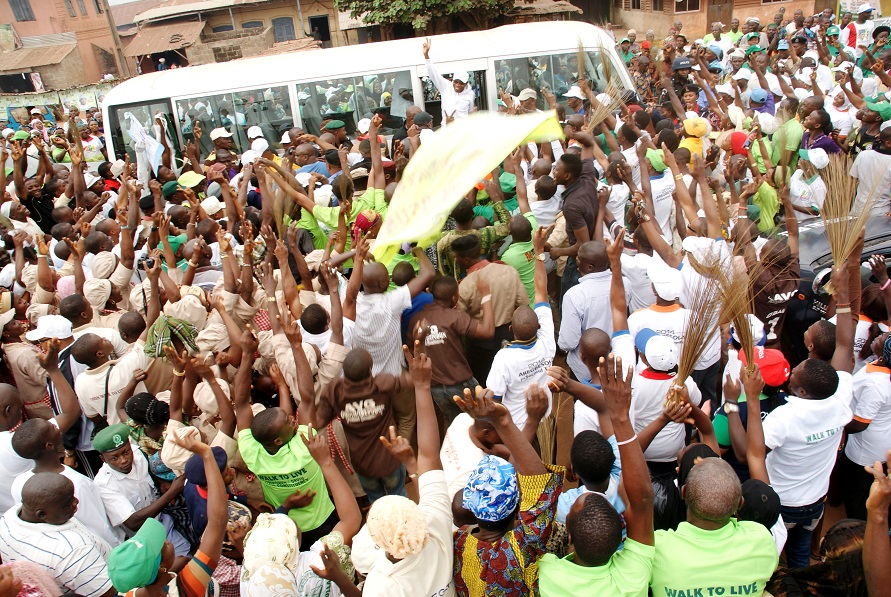 Governor State of Osun, Ogbeni Rauf Aregbesola acknowledging cheers from the crowd, during the 14th Edition of the Walk to live for Healthy Living Exercise in Ilobu, Irepodun/Orolu State Constituency on Saturday 18-01-2014