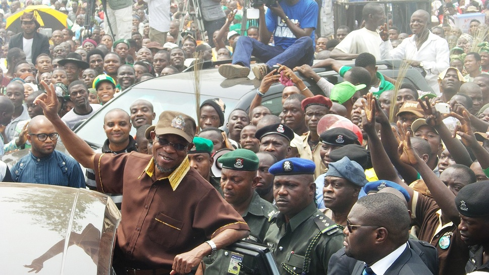 Governor State of Osun, Ogbeni Rauf Aregbesola, acknowledging cheers from the crowd after the official commissioning of Baptist Central Elementary School in Ilare, Ile-Ife, the State of Osun on Tuesday 18-02-2014