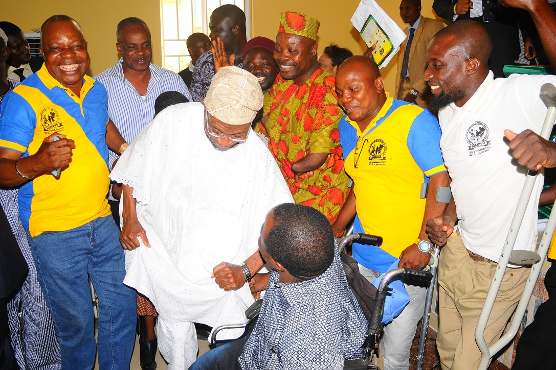 Governor State of Osun, Ogbeni Rauf Aregbesola (2nd right); Special Adviser to the Governor on Youths, Sports and Special Needs, Comrade Biyi Odunlade (2nd left); Special Adviser to Oyo State Governor on Special People, Prince Paul Adelabu (left) and Special Adviser to the Governor on Home Affairs, Culture and Tourism, Mr Ladipo Soyode, during the Celebration of Persons with Disabilities and Declaration of Support for Aregbesola's Second Term in office, at Local Government Civil Service Commission hall, Osogbo, State of Osun