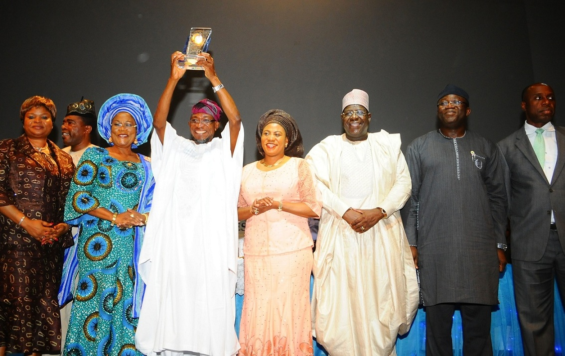 From left, Lagos State Deputy Governor, Mrs Adejoke Adefulure; Deputy Governor State of Osun, Mrs Titi Laoye-Tomori; Governor, Ogbeni Rauf Aregbesola; his Wife Sherifat; Chairman of the occasion/Chairman, Independent Newspaper Limited (INL), Alhaji Gambo Lawan; Kayode Fayemi of Ekiti State and Rotimi Ameachi of Rivers State, during the Investiture of Aregbesola as the 2013 Man of the Year, at Eko Hotel and Suites, Lagos on Friday 21-02-2014 Man of the Year-3
