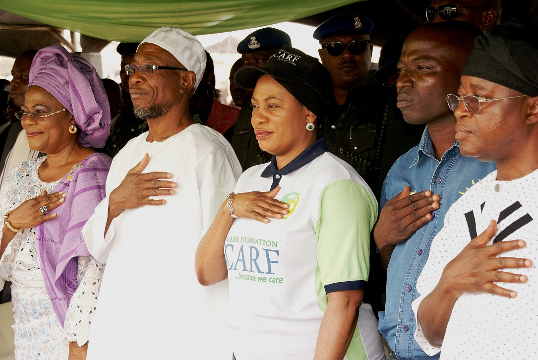 From left, Deputy Governor, State of Osun, Mrs Titi Laoye-Tomori; Governor, Ogbeni Rauf Aregbesola; his Wife, Sherifat; Managing Director, Peak School Smart, Mr Ezekiel Salami and Chief of Staff, Alhaji Gboyega Oyetola, during the distribution of Sheri Care Foundation (SCARF) Milk of Knowledge to Pupils in Public Elementary Schools in the State, at Nelson Mandela Freedom Park, Osogbo, State of Osun on Thursday 20-02-2014