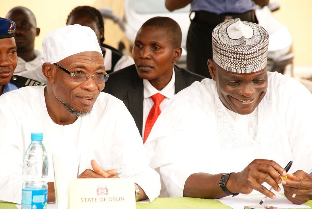 Governor State of Osun, Ogbeni Rauf Aregbesola (left) and Outgoing State Director, Security (SDS), Mr. Joshua Yakubu (right), during his Send-forth Ceremony in Osogbo, State of Osun