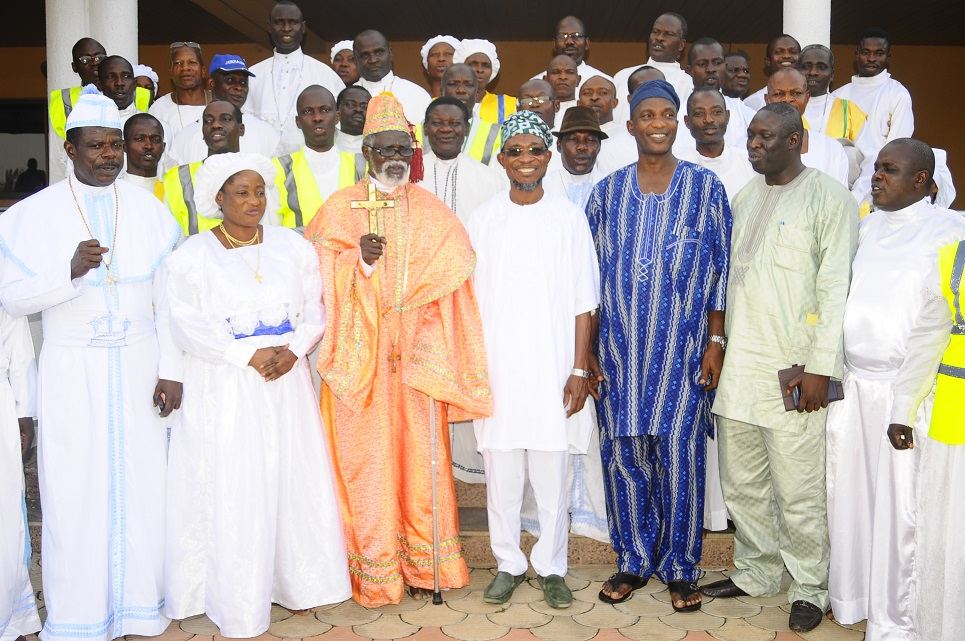 Governor State of Osun, Ogbeni Rauf Aregbesola (centre); Secretary to the State Government, Alhaji Moshood Adeoti (3rd right); Special Adviser to the Governor on Environment and Sanitation, Mr Bola Ilori (2nd right); Spiritual Head, Celestial Church of Christ (CCC) Worldwide, Prophet Paul Maforikan (3rd left); Head, Osun Arch-Diocese CCC, Evangelist Samson Adelani (left); Matron, Osun CCC, Mother Celestial Sola Maforikan (2ndleft); Chairman Osun 2014 Revival planning Committee, Evangelist Abiodun Awodeji (right) and others, during a Courtesy Visit by the CCC Worldwide and Pledging Support for the Governor's Second term in Office, at Government House, Osogbo, State of Osun on Wednesday 19-03-2014