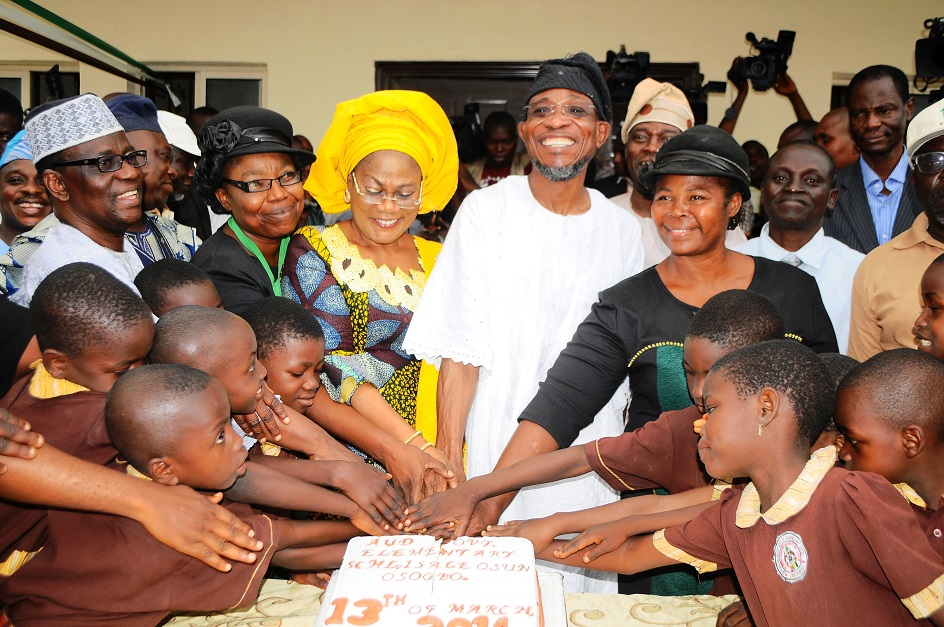 Governor State of Osun, Ogbeni Rauf Aregbesola (2nd right); his Deputy, Mrs Titi Laoye-Tomori (3rd left); Chairman, State Universal Basic Education Board (SUBEB), Prince Felic Awofisayo (left); First Headmistress of the School, Mrs Yahaya Ibironke (right); Second Headmistress of the School, Mrs Bola Ajala (right) and others, during the commissioning of Ansar-Ul-Deen (AUD) Government Elementary School in Isale-Osun, Osogbo, State of Osun on Thursday 13-03-2014