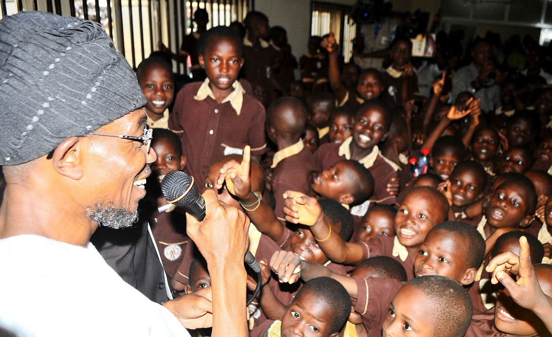 Governor State of Osun, Ogbeni Rauf Aregbesola (left) addressing the enthusiastic pupils of Ansar-Ul-Deen (AUD) Government Elementary School after the commissioning in Isale-Osun, Osogbo, State of Osun on Thursday 13-03-2014