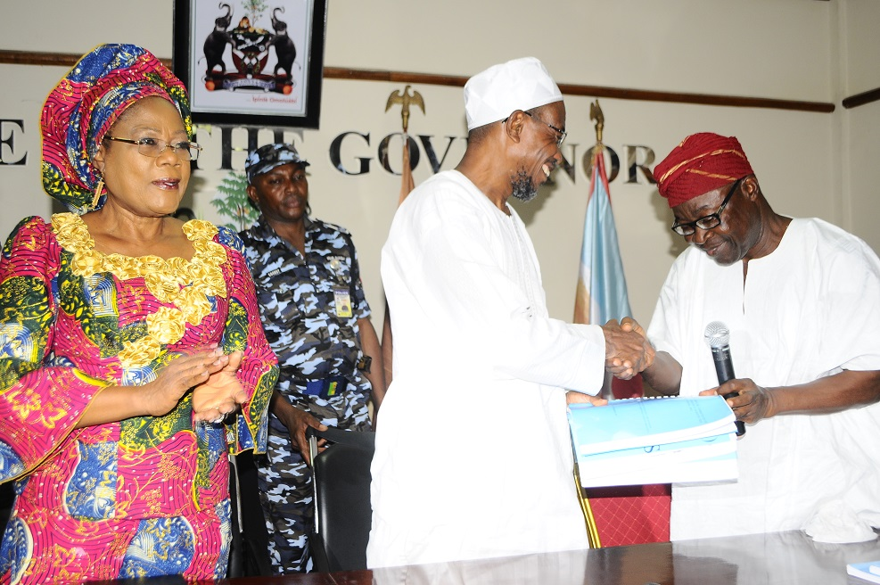 Governor State of Osun, Ogbeni Rauf Aregbesola, receiving a report on Religious Disturbance at Baptist High School, Iwo from Chairman of the committee, Chief Morenikeji Adedeji (right). during the Committee's submission of their report at Office of the Governor, Abere, State of Osun on Monday 17-03-2014. With them is, Deputy Governor, Mrs Titi Laoye-Tomori.