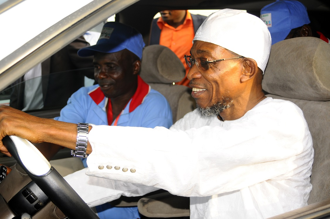 Governor State of Osun, Ogbeni Rauf Aregbesola test driving one of the Campaign Vehicles presented to him by the Board of Local Government Education Authority (LGEA) during his Endorsement for Second term in office by the Board at Nelson Mandela Freedom Park, Osogbo, State of Osun on Sunday 23-03-2014. With him is, Chairman of Chairmen, Board of Local Government Education Authority (LGEA), Honourable Isa Ojewale.