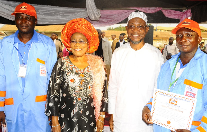 Governor State of Osun, Ogbeni Rauf Aregbesola (2nd right); his Deputy, Mrs Titi Laoye Tomori (2nd left); Chairman, Nigeria Automobile Technician Association (NATA), Olorunda Local Government Chapter, Comrade Ajileye Olawale (left) and NATA Chairman, Osogbo Local Government Chapter, Comrade Oyewole Kamorudeen (right), during the governor's Endorsement for Second Term in Office and Inauguration of State Executives at Nelson Mandela Freedom Park, Osogbo on Thursday 20-03-2014