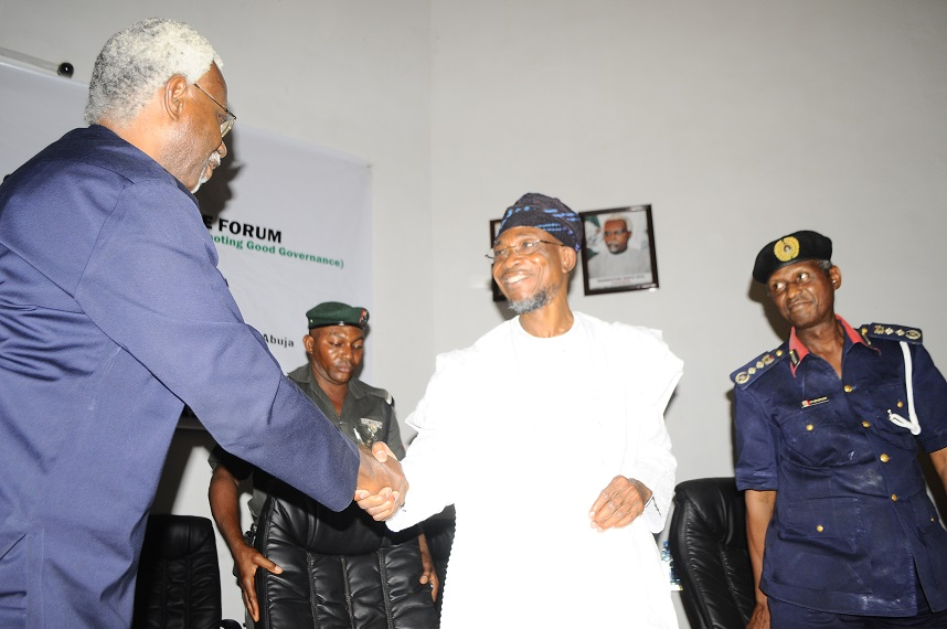 Governor State of Osun/Guest speaker, Ogbeni Rauf Aregbesola (middle); Chairman Independent Corrupt Practices & Other Related Offences Commission (ICPC), Mr. Ekpo Nta (left) and Commandant Nigeria Security and Civil- Defence Corp, Dr. Ade Abolurin (right), during the First 2014 Independent Corrupt Practices & Other Related Offences Commission (ICPC) Good Governance Forum at ICPC Auditorium, Abuja on Tuesday 11/03/2014.