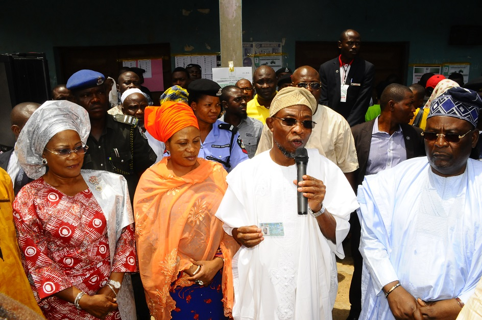 From left, Deputy Governor State of Osun, Mrs Titi Laoye-Tomori; wife of the Governor, Mrs Sherifat Aregbesola; Governor, Ogbeni Rauf Aregbesola; Chairman, Resident Electoral Commissioner, Ambassador Rufus Akeju and others, during the collection of their Permanent Voter cards at Ward 8, Ilesa East Local Government, Ilesa, State of Osun on Friday 07-03-2014