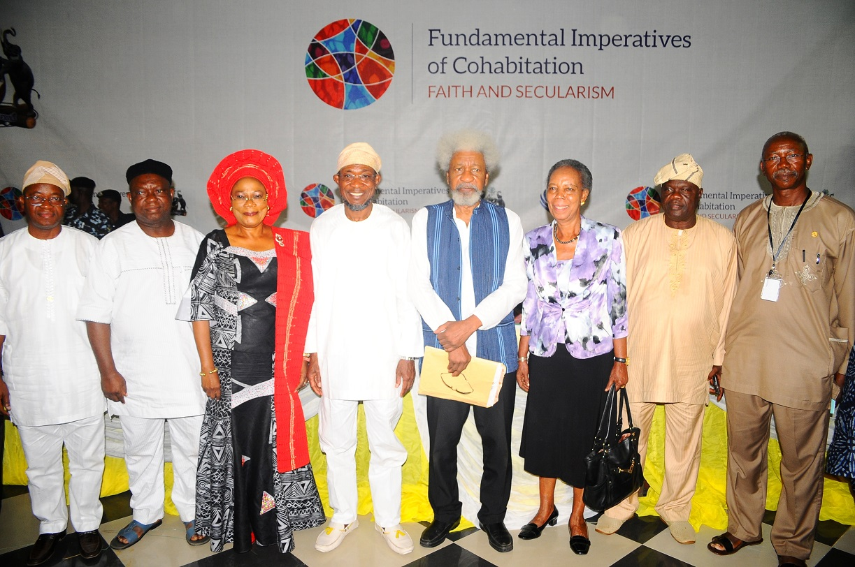 Governor State of Osun, Ogbeni Rauf Aregbesola (4th left); his Deputy, Mrs Titi Laoye-Tomori (3rd left); Chairman, Centre for Black Culture and International Understanding (CBCIU), Professor Wole Soyinka (4th right); Deputy Speaker, State Assembly of Osun, Honourable Akintunde Adegboye (2nd left); Director, Development Policy Centre, Ibadan, Professor Bimpe Aboyade (3rd tight); Chief of Staff to the Governor, Alhaji Gboyega Oyetola (left); Deputy Chief of Staff to the Governor, Mr Gbenga Adebusuyi (right) and Major Debo Basorun (2nd right), during the Opening Ceremony of All-Comers Colloquium tagged:- Fundamental Imperatives of Cohabitation: Faith and Secularism, at the CBCIU Auditorium, Abere, Osogbo, State of Osun