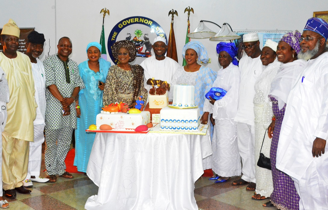 Governor State of Osun, Ogbeni Rauf Aregbesola; his Wife,  Sherifat; Deputy Governor, Mrs. Titi Laoye-Tomori (5th left), Special Advisers Youth, Sport and Special Need, Comrade Biyi Odunlade (3rd left), Member House of Representatives in Irewole, Ayedaade, Isokan, Federal Constituency, Hon. Ayo Amidiran (5th left), Prof. Siyan Oyeweso (left), Commissioner Regional Integration and Special Duties, Mr. Surajudeen Ajibola  Basiru (4th right) Vice Chancellor, Osun State University, Osogbo, Professor Adekunle Bashir Okesina (right) and others, during the 57th Birthday celebration of Governor Aregbesola, at Government house Osogbo
