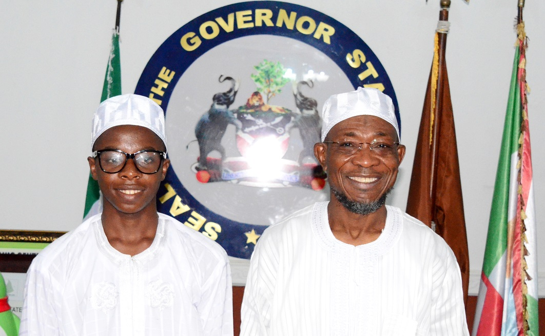 Governor State of Osun, Ogbeni Rauf Aregbesola (right) with the Overall Winner, State of Osun Public Schools Debate, Ayodele Habibllah (left), during his One-day with Ogbeni after Winning the Osun High School's Unity Debate Competition at Government House Osogbo, State of Osun on Monday 26-05-2014