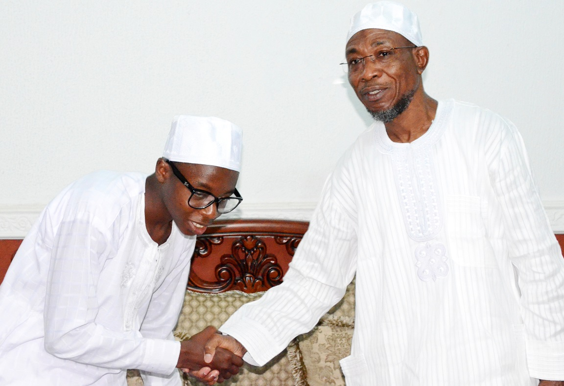 Governor State of Osun, Ogbeni Rauf Aregbesola (right) welcoming the Overall Winner, State of Osun Public Schools Debate, Ayodele Habibllah (left) to the Government House, during his One-day with Ogbeni in Osogbo, State of Osun on Monday 26-05-2014