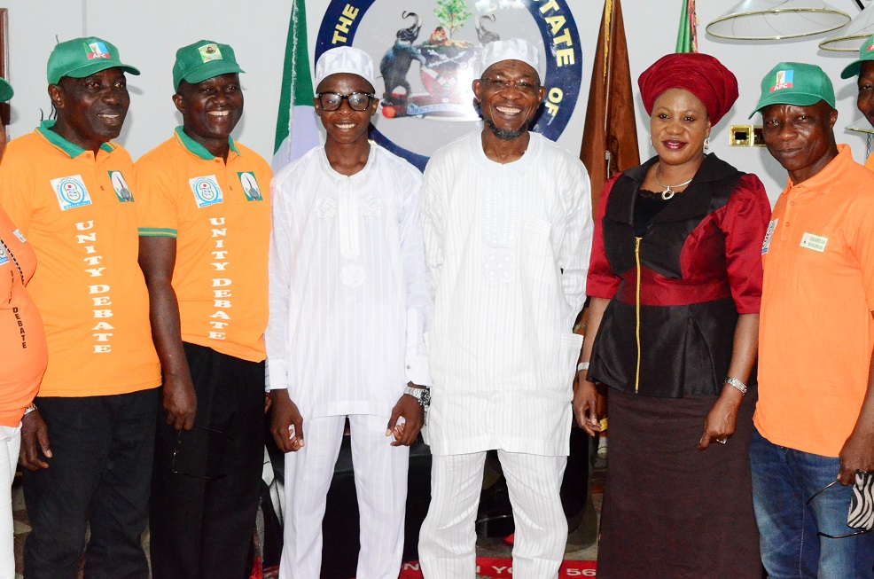 Governor State of Osun, Ogbeni Rauf Aregbesola (3rd right); his Wife, Sherifat (2nd right); Overall Winner, State of Osun Public Schools Debate, Ayodele Habibllah (3rd left); Chairman, Omoluabi Support Group (OSG), Pastor Israel Alagbe (left); Chairman, Lagos State House of Committee on Transportation, Commerce and Industry, Honourable Bisi Yusuf (right) and Secretary OSG, Barrister Kayode Tinubu (2nd left), during his One-day with Ogbeni after Winning the Osun High School's Unity Debate Competition at Government House Osogbo, State of Osun on Monday 26-05-2014