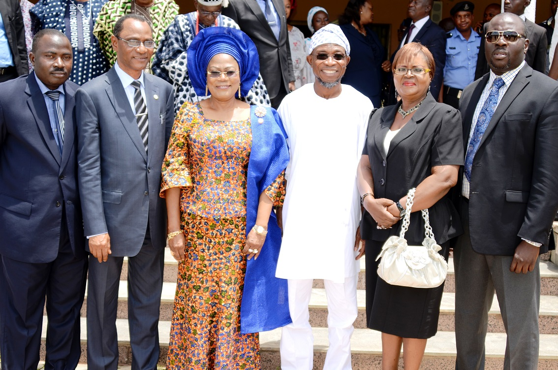 Governor State of Osun, Ogbeni Rauf Aregbesola (3rd right); his Deputy, Mrs Titi Laoye-Tomori (3rd left); Newly Sworn-in Chairman, Commission of Inquiry on Disturbance of Public Peace, Justice Adekunle Adeigbe (2nd right); Secretary of the Commission, Mr Bisi Babalola (right); Members of the Commission, Retired Deputy Commissioner of Police, Bose Dawodu (2nd right) and Barrister Ismail Ajibade (left), during the Inauguration of the Commission at, Government House, Osogbo, State of Osun on Thursday 15-05-2014