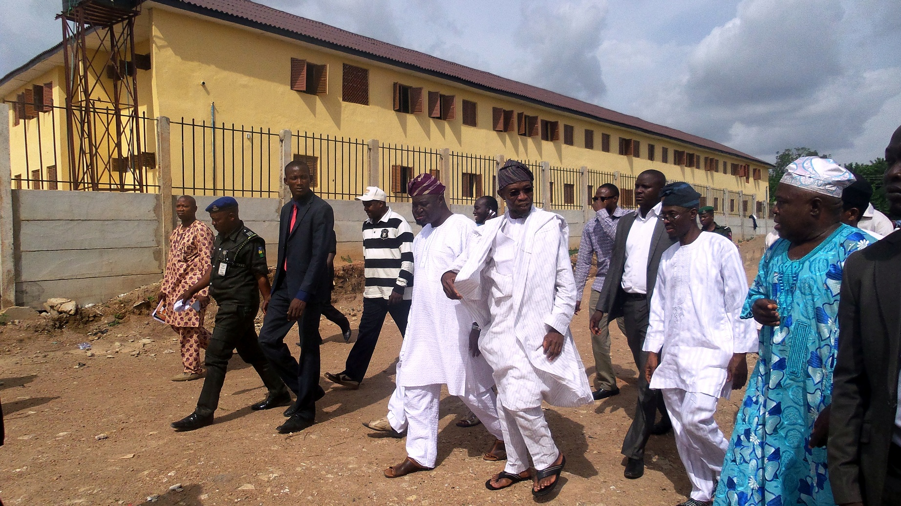 Governor State of Osun, Ogbeni Rauf Aregbesola (middle); Senator Bayo Salami (5th left); Education Liaison officer, Osogbo Local Government, Alhaji Sulaiman Afariogun (right); Governor's Aids, Mr Adebayo Young (2nd right) and others, during an inspection visit to the newly completed Laro Timehin Middle School, Osogbo on Friday 23-05-2014