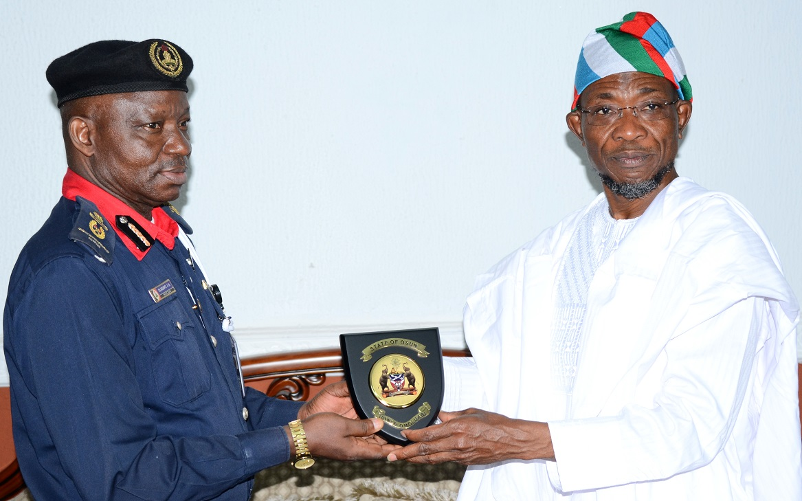 "Governor State of Osun, Ogbeni Rauf Aregbesola (right) and Assistant Commandant General, Nigeria Security and Civil Defense Corps (NSCDC) Zone ""F"", Oladayo Amujare, during the Assistant Commandant's Visit to the Governor in Government House, Osogbo, State of Osun on Friday 16-05-2014"