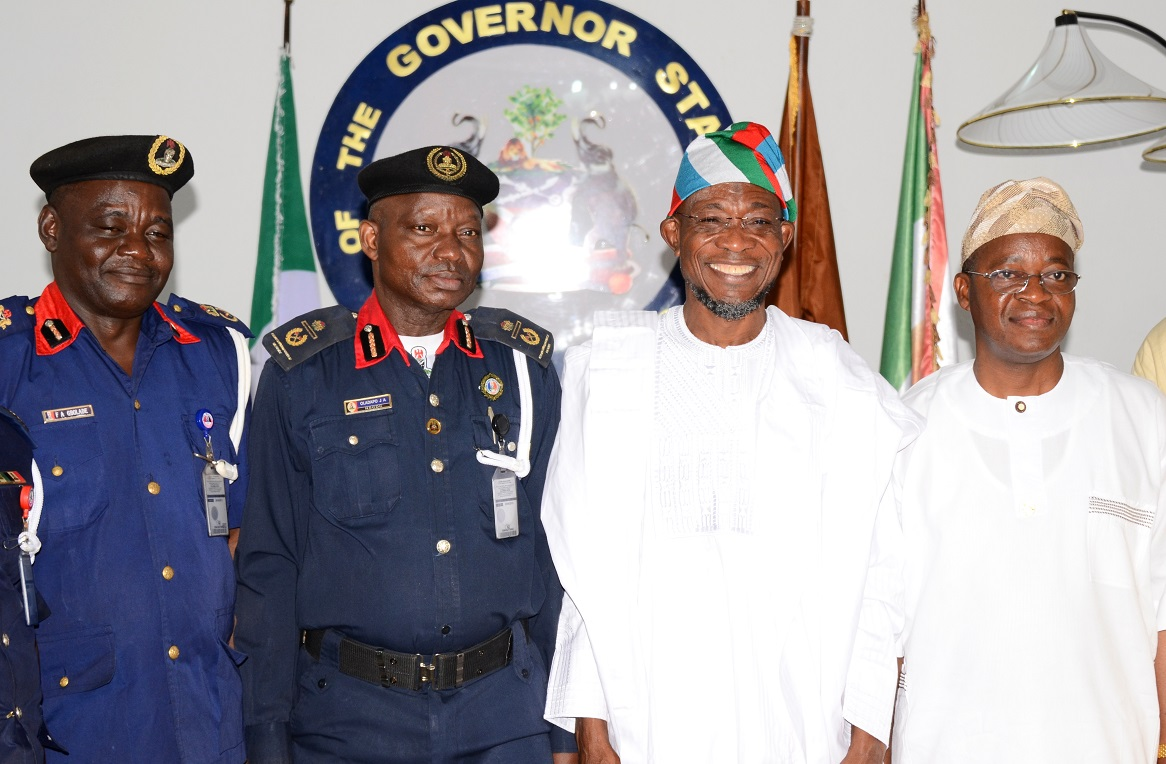"Governor State of Osun, Ogbeni Rauf Aregbesola (2nd right); Assistant Commandant General, Nigeria Security and Civil Defense Corps (NSCDC) Zone ""F"", Oladayo Amujare (2nd left); Chief of Staff to the Governor, Alhaji Gboyega Oyetola (right) and State of Osun NSCDC Commandant, Engineer Gbolade Felix (left), during the Assistant Commandant's Visit to the Governor in Government House, Osogbo, State of Osun on Friday 16-05-2014"