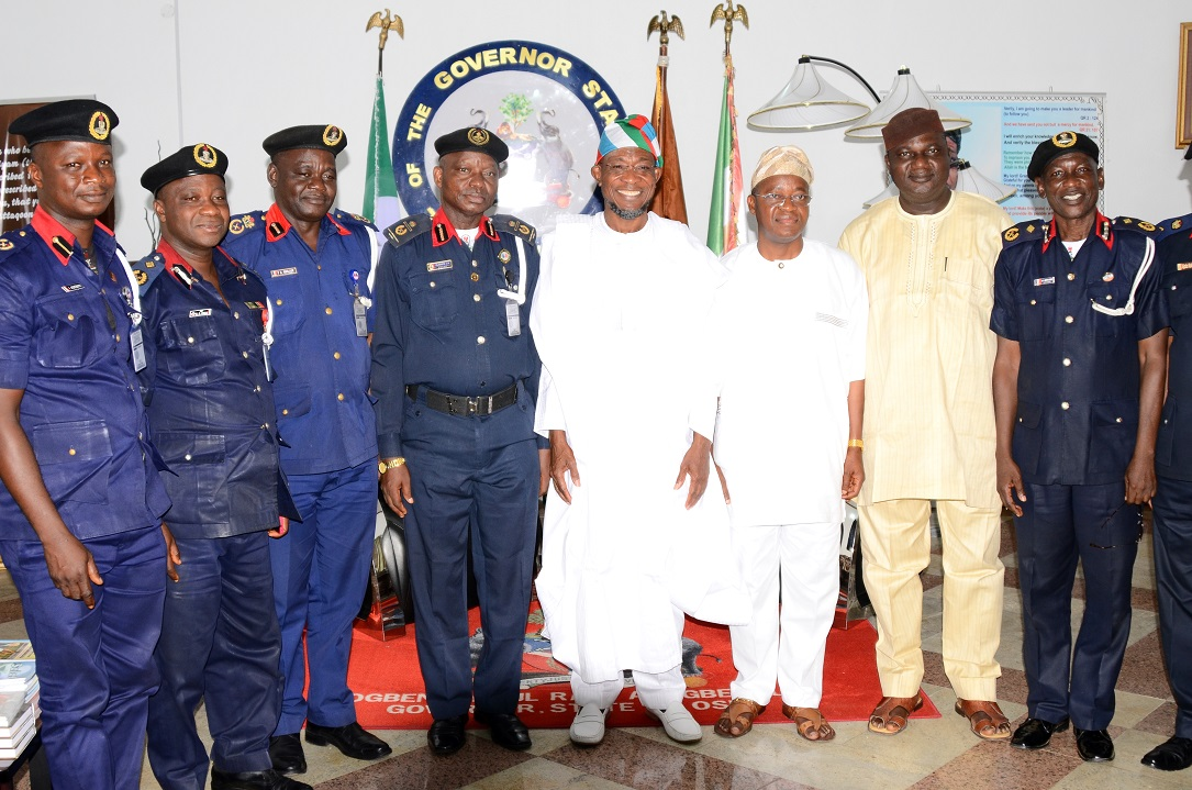 "Governor State of Osun, Ogbeni Rauf Aregbesola (4th right); Assistant Commandant General, Nigeria Security and Civil Defense Corps (NSCDC) Zone ""F"", Oladayo Amujare (4th left); Chief of Staff to the Governor, Alhaji Gboyega Oyetola (3rd right); State of Osun NSCDC Commandant, Engineer Gbolade Felix (3rd left); Deputy Commandant, Operations NSCDC, Issa Akanbi (2nd left); Deputy Commandant NSCDC, Basiru Abdulazeez (right); Assistant Commandant, Head of Training, Adebiyi Ishola (left) and Interim Chairman, All Progressives Congress (APC), Osun Chapter, Elder Adelowo Adebiyi (2nd right), during the Assistant Commandant's Visit to the Governor in Government House, Osogbo, State of Osun on Friday 16-05-2014"