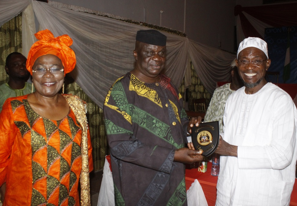 Governor State of Osun, Ogbeni Rauf Aregbesola, Presenting a gift to the Chairman, National Uunion of Road Transport Workerd (NURTW), State of Osun Chapter,  Alhaji Isiaka Afolabi (middle). With them is Deputy Governor Titi Laoye-Tomori, during a dinner organised for NURTW members, at Government House, Osogbo, State of Osun