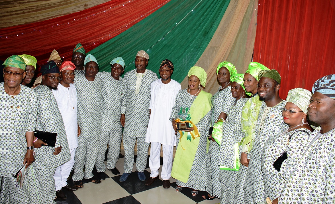 Governor State of Osun, Ogbeni Rauf Aregbesola (centre); his wife, Sherifat (middle); Secretary to the State Government, Alhaji Moshood Adeoti (5th right); Commissioner for Health, Dr Temitope Ilori (6th right); Chief of Staff to the Governor, Alhaji Gboyega Oyetola (4th left) and other members of the State Exco, during the Formal Presentation of National Infinity Magazine's Nigerian of the Year 2013 Award to Aregbesola, at Centre for Black Culture and International understanding, Abere, State of Osun on Saturday 24-05-2014.