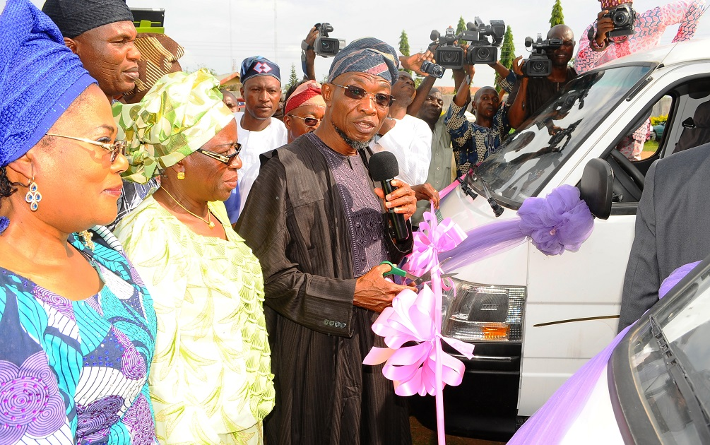 Governor State of Osun, Ogbeni Rauf Aregbesola (3rd left); his Deputy, Mrs Titi Laoye-Tomori (left); Special Adviser to the Governor on Tertiary Institutions, Alhaja Mulikat Bello (2nd left) and others, during the Commissioning of four 18-Seater Buses for the Student Union Government (SUG) of the State-Owned Tertiary Institutions at Government House Lawn, Osogbo, State of Osun on Friday 02-05-2014